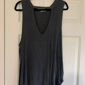Tank top with front cut out.